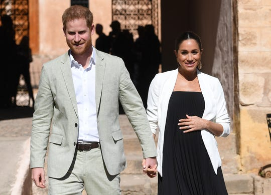 In this Monday, Feb. 25, 2019 file photo, Britain's Prince Harry and Meghan, Duchess of Sussex visit the Andalusian Gardens in Rabat, Morocco, Monday, Feb. 25, 2019.