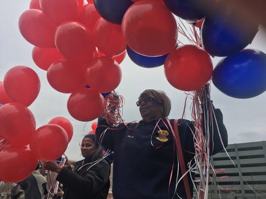 Detroit resident Sharon Parnell holds balloons during a ceremony honoring the late Detroit police spokeswoman Sgt. Eren Stephens