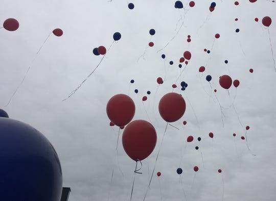 Dozens of balloons were released Thursday to honor the late Detroit police Sgt. Eren Stephens