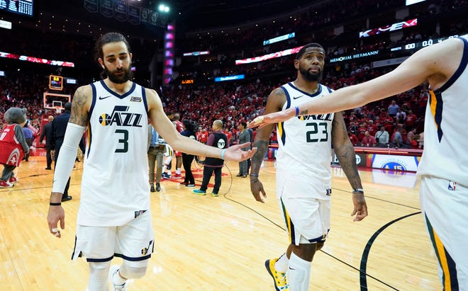 Utah Jazz guard Ricky Rubio (3) and forward Royce O'Neale (23) walk off the court after losing to the Houston Rockets in Game 5.