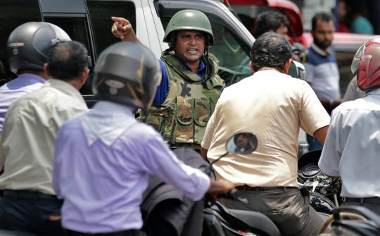 Sri Lankan navy soldiers perform security checks on motorists at a road in Colombo, Sri Lanka, Thursday, April 25, 2019.