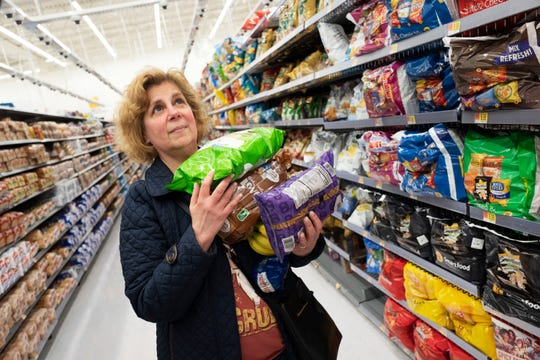"Marcy Seinberg shops at a Walmart Neighborhood Market, Wednesday, April 24, 2019, in Levittown, N.Y. Despite the signs and visible cameras many shoppers, including Seinberg, didn't seem to notice or care. ""I am not bothered by it,"" Seinberg said. ""If technology saves me money, I would be interested."" (AP Photo/Mark Lennihan)"
