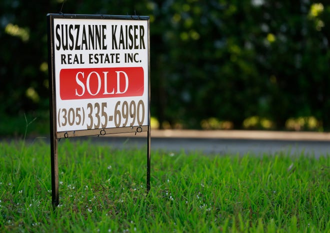 A sold sign is shown in front of a home in Surfside, Fla.