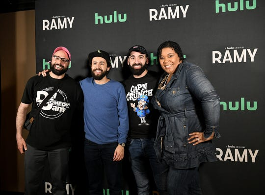 From left, Comedians Dave Merheje, Ramy Youssef and, at far right, Crystal P., take a group photo with emcee Joey Namou from the Mojo in the Morning show after the show at Mark Ridley's Comedy Castle in Royal Oak, Mich. on April 23, 2019.  