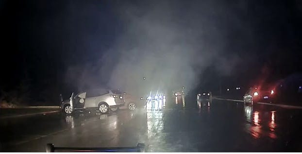 Officers rescue an unconscious driver from a vehicle on fire.