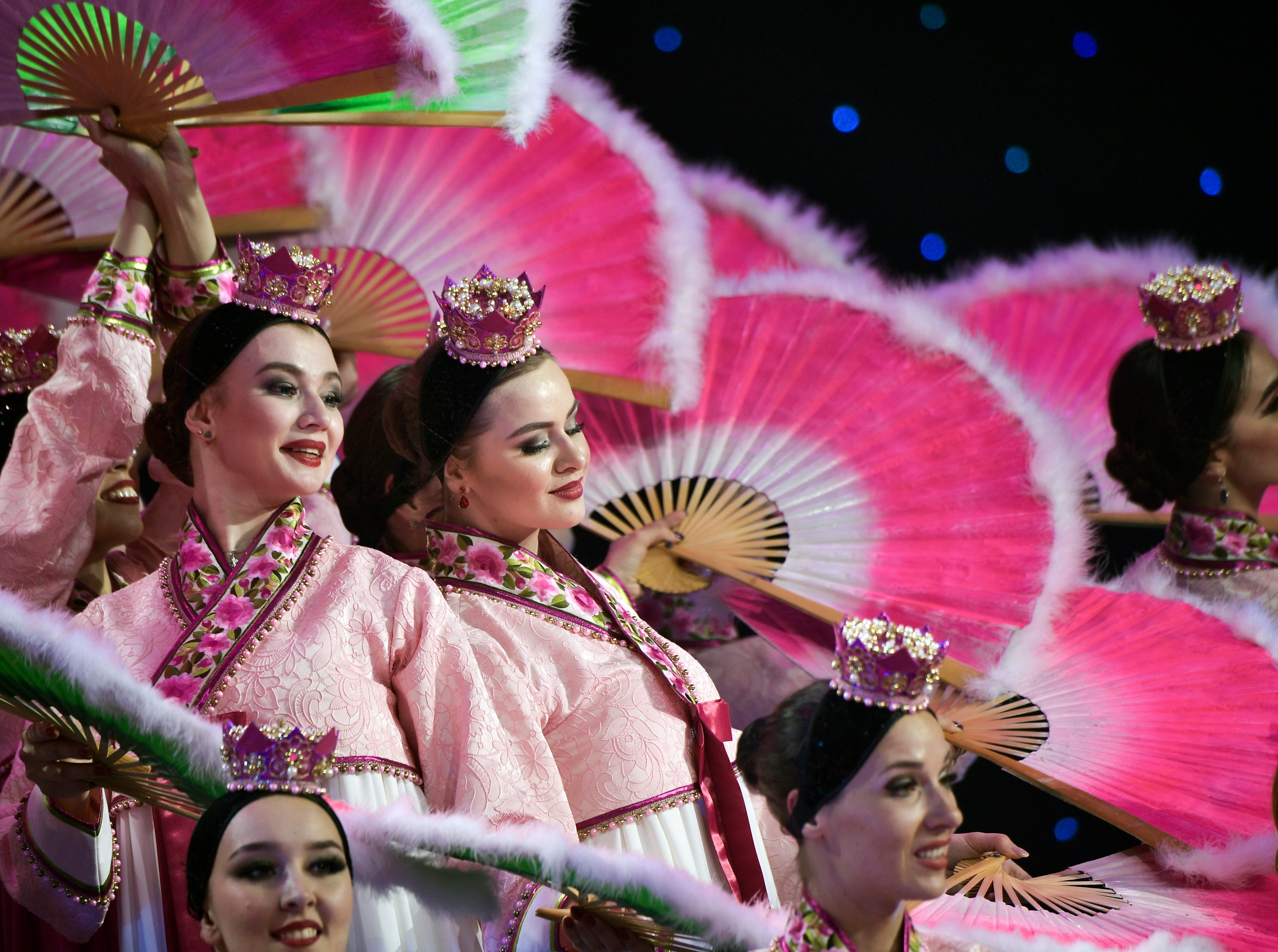 Artists perform during a reception after talks between Russian President Vladimir Putin and North Korean leader Kim Jong Un at the Far Eastern Federal University campus on Russky Island in Vladivostok, Russia, Thursday, April 25, 2019. President Vladimir Putin says after talks with North Korean leader Kim Jong Un that Pyongyang is ready to proceed toward denuclearization, but that it needs serious security guarantees to do so.