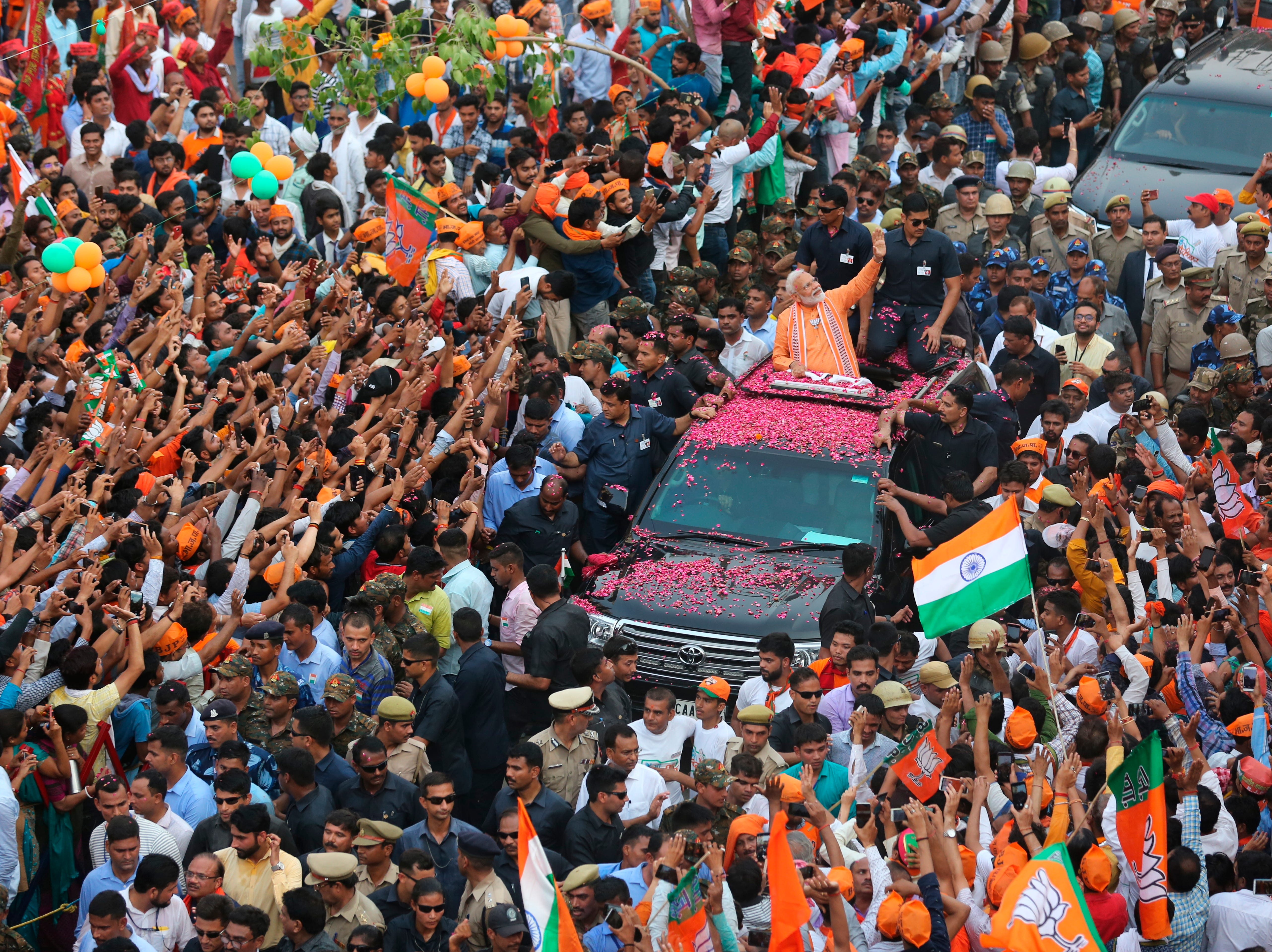 Indian Prime Minister Narendra Modi waves to the crowd during a political campaign road show in Varanasi, India, Thursday, April 25, 2019. The ongoing general election is seen as a referendum on Modi's five-year rule. He has adopted a nationalist pitch in trying to win votes from the country's Hindu majority by projecting a tough stance against Pakistan, India's Muslim-majority neighbor and archrival.