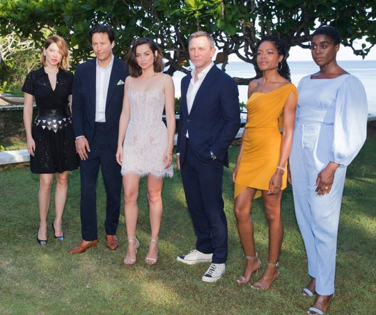Actress Lea Seydoux, from left, director Cary Joji Fukunaga, actors Ana de Armas, Daniel Craig, Naomie Harris and Lashana Lynchin Oracabessa, Jamaica, Thursday, April 25, 2019.
