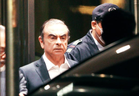 Former Nissan Chairman Carlos Ghosn leaves the Tokyo Detention Center, in Tokyo Thursday, April 25, 2019.