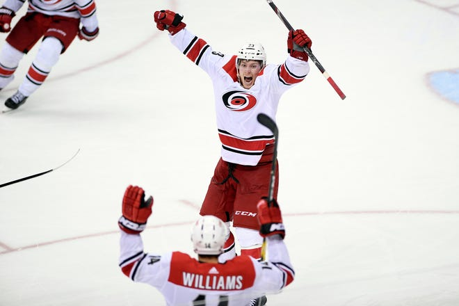 Carolina Hurricanes left wing Brock McGinn (23) celebrates his winning goal with Justin Williams (14) in double overtime of Game 7.