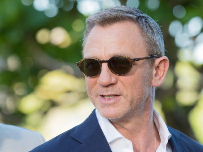 Actor Daniel Craig poses for photographers during the photo call of the latest installment of the James Bond film franchise, currently known as 'Bond 25', in Oracabessa, Jamaica, Thursday, April 25, 2019.