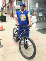 Dejuan Miller, of Elmira, rides his bicycle everywhere, and says a dedicated bicycle corridor connecting Elmira to Horseheads is a great idea.