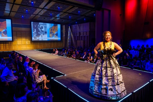 """""""Micro Macro,"""" modeled and designed by Megan Walsh in the 2018 ReCouture runway show. The outfit's materials are scientific slides, film and images from Walsh's father's research collection."""
