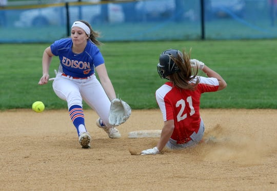 Wendi Hammond of Waverly slides safely into second base as Thomas A. Edison shortstop KK Busch waits on the throw April 25, 2019 at Cohen Elementary School in Elmira Heights.
