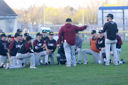 Elmira head coach Jason Manwaring talks to his team after a 5-0 win over Corning in baseball April 24, 2019 at Ernie Davis Academy.