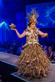 """""""The Forest Floor,"""" created by Donna Morgan and modeled by Lauren Finnell in the 2017 ReCouture runway show.  The materials are made of nature's refuse, including branches, feathers, bark and a bird's nest."""