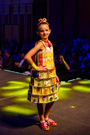 """""""McDiva,"""" modeled and designed by Alexis Collins. Collins uses McDonald's Happy Meal toys and packaging to create her look."""