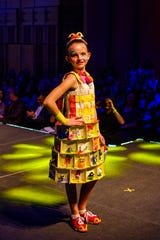 """McDiva,"" modeled and designed by Alexis Collins. Collins uses McDonald's Happy Meal toys and packaging to create her look."