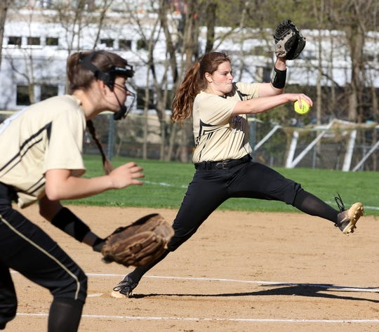 Laura Bennett delivers a pitch for Corning during a 2-0 win over Elmira in softball April 24, 2019 at Ernie Davis Academy.