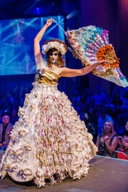 """""""La Catrina al Rockwell,"""" created by Amy Ruza, Delanie Sickler and Willa Vogel, and modeled by Kristen Merritt-Edger in the 2017 ReCouture runway show.  The look is made of postcards and staff recyclables from the Rockwell Museum."""
