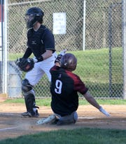 Carter Allen of Elmira slides home with a run in the fourth inning of Elmira's 5-0 win over Corning in baseball April 24, 2019 at Ernie Davis Academy.