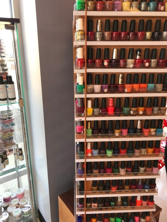 More than 400 nail polishes and 700 gel colors are available for customers to choose from at the nail salon which moved from Forest Mall to 190 W. Johnson St. earlier this month.