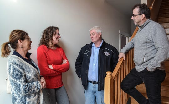 Elmore Airbnb owners talk about the perks – to them and the town – of renting extra space to travelers during an Elmore Airbnb open house on April 2. Kathy Pietrowski, second from left, was the first to open an Airbnb in Elmore. She said hers, a second-floor studio apartment, was rented every day last summer. Also pictured are Cyndi Wheeler, D.J. Greenhill, and Tim Wheeler.