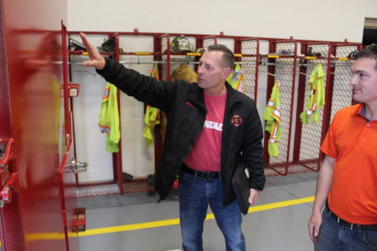 Sandusky Township Fire Chief Dean Schneider surveys a new forced entry training door for the Sandusky County Firefighters Association as firefighter Lucas Preston-Colvin looks on Wednesday at Clyde Fire Station No. 2 on McPherson Highway.