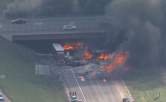 A large multivehicle fire has closed I-70 in Denver on Thursday.