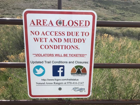 A sign on a gate at Maxwell Natural Area warns visitors the consequences of recreating on the trails when the area is closed.
