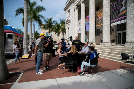 """A film crew from the Food Network's """"The Great Food Truck Race"""" interview customers of the food trucks in downtown Fort Myers on Thursday, April 25, 2019."""