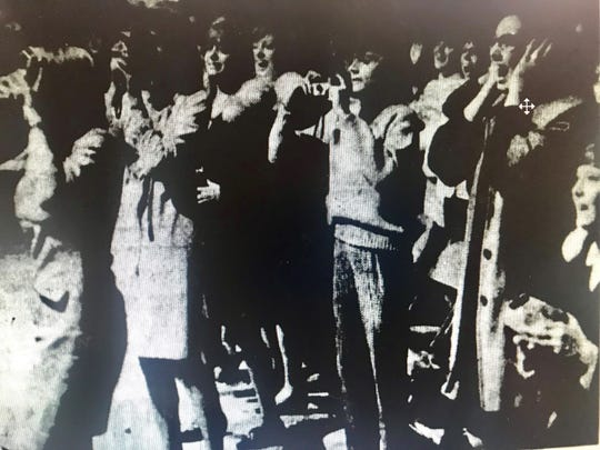 Teenage fans react to Sonny & Cher onstage at Brown County Veterans Memorial Arena in 1965.