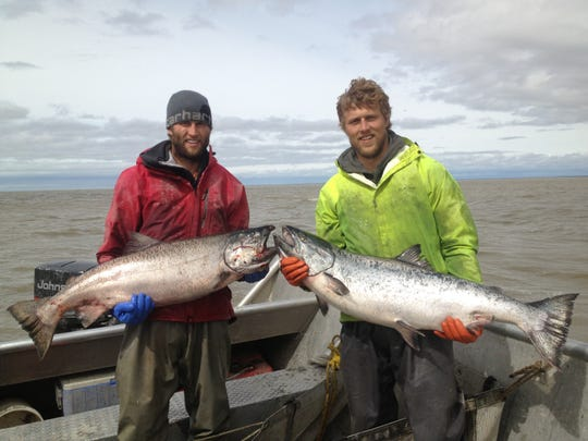 Levi Gill (right) said salmon fishing is a fun way to work with your hands and your back, but still having to think about what you're doing.