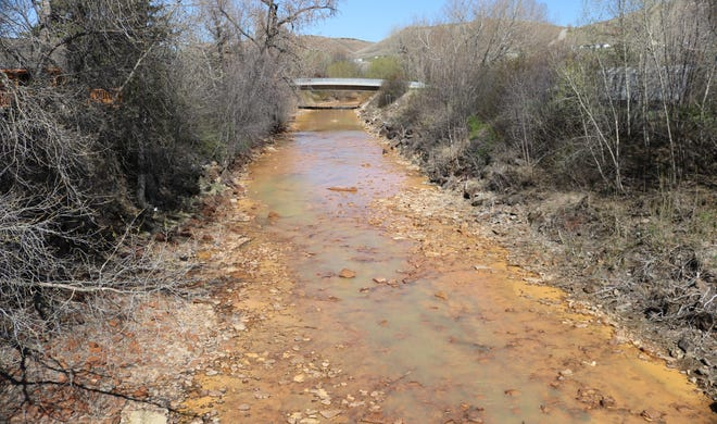 Belt Creek, tainted by heavy metals, flows through the heart of Belt.