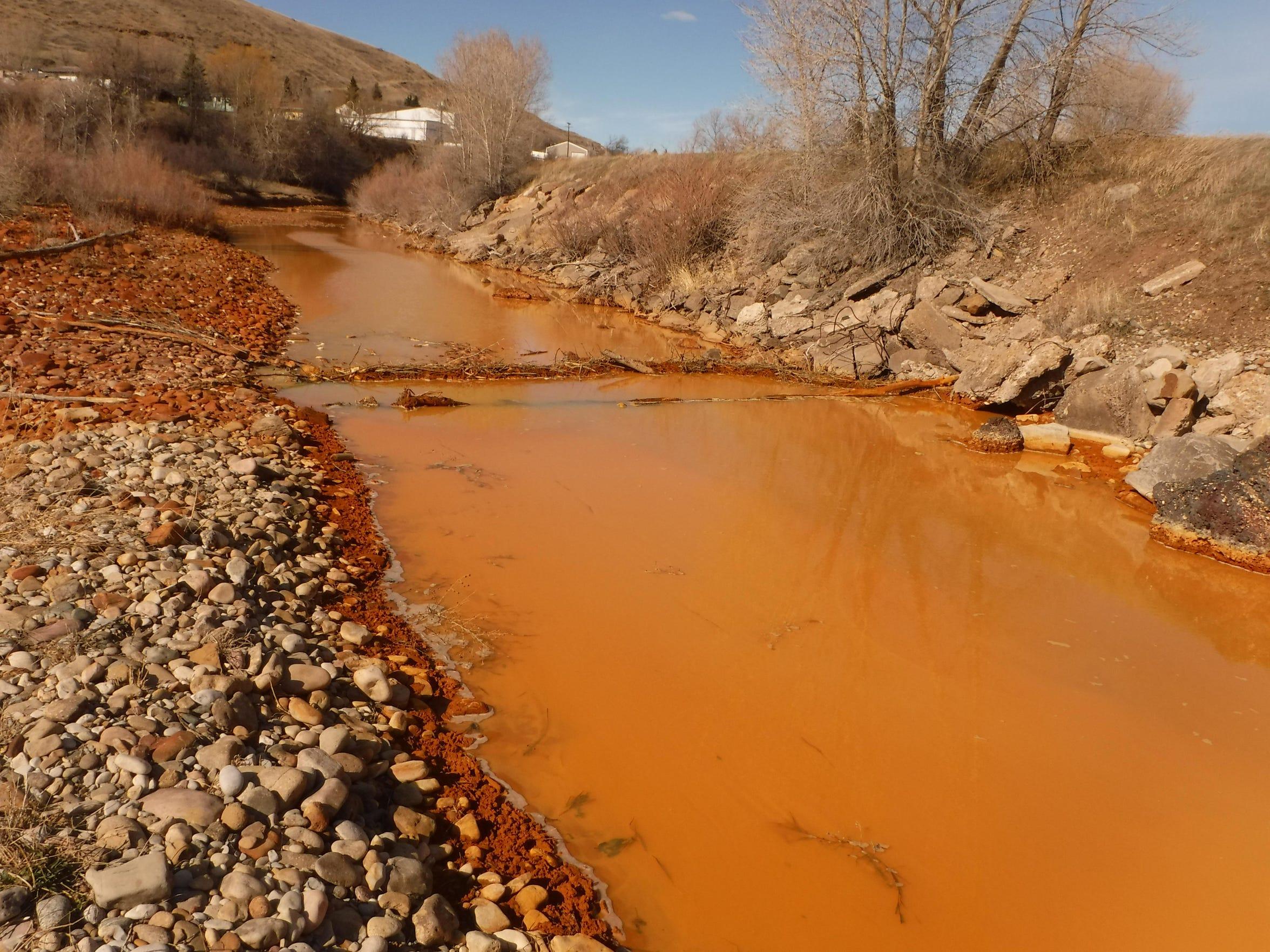 Belt Creek often runs orange because of drainage from an abandoned coal mine.