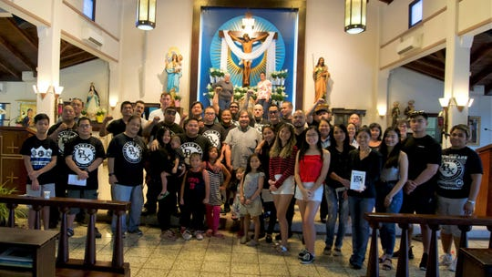 DLX members visit the Agana Heights church.