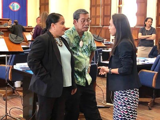 Speaker Tina Muna Barnes, left, confers with Sens. Joe San Agustin and Regine Biscoe Lee during a brief session break on April 25, 2019.