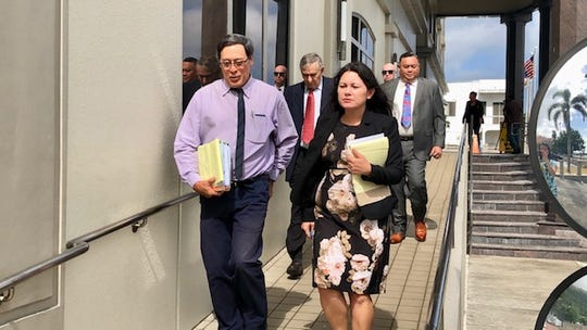 Attorneys for plaintiffs and defendants in Guam's clergy sex abuse cases exit the U.S. District Court of Guam building Thursday morning after a joint status conference on the cases.