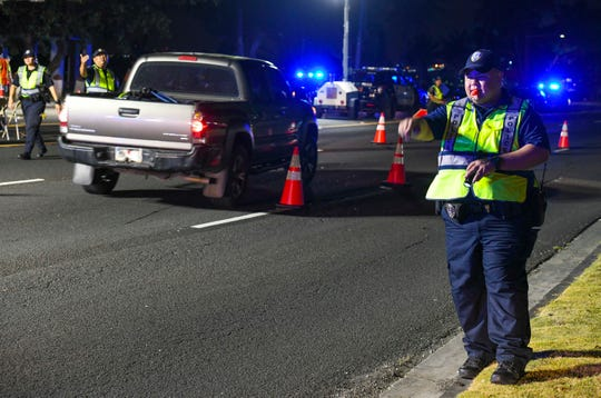 Officers with the Guam Police Department's Highway Traffic Division conduct a DUI checkpoint on Marine Corps Drive, near the U.S. District Court building in Hagåtña, on the evening of Wednesday, April 24, 2019. During the operation at the site, two drivers were taken into custody for the suspicion of driving under the influence, said GPD Officer A.S. Bueno.