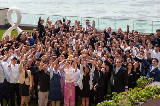"""Dusit Thani Guam Resort employees gather at Villa Azul to celebrate winning six corporate awards including """"Hotel of the Year"""" and """"Dusit Gracious Employer of Choice"""" for 2018."""