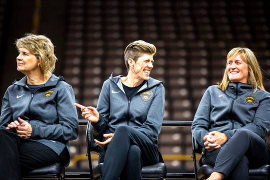Iowa head coach Lisa Bluder, from left, associates Jan Jensen and Jenni Fitzgerald share a moment together on stage during a celebration of the 2018-19 Hawkeyes women's basketball season, Wednesday, April 24, 2019, at Carver-Hawkeye Arena in Iowa City, Iowa.
