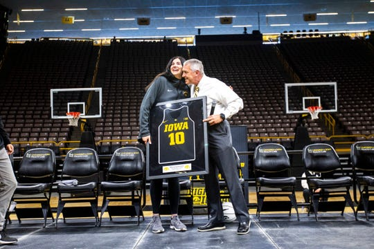 Iowa athletics director Gary Barta, right, embraces Iowa center Megan Gustafson (10) during a celebration of the 2018-19 Hawkeyes women's basketball season, Wednesday, April 24, 2019, at Carver-Hawkeye Arena in Iowa City, Iowa.