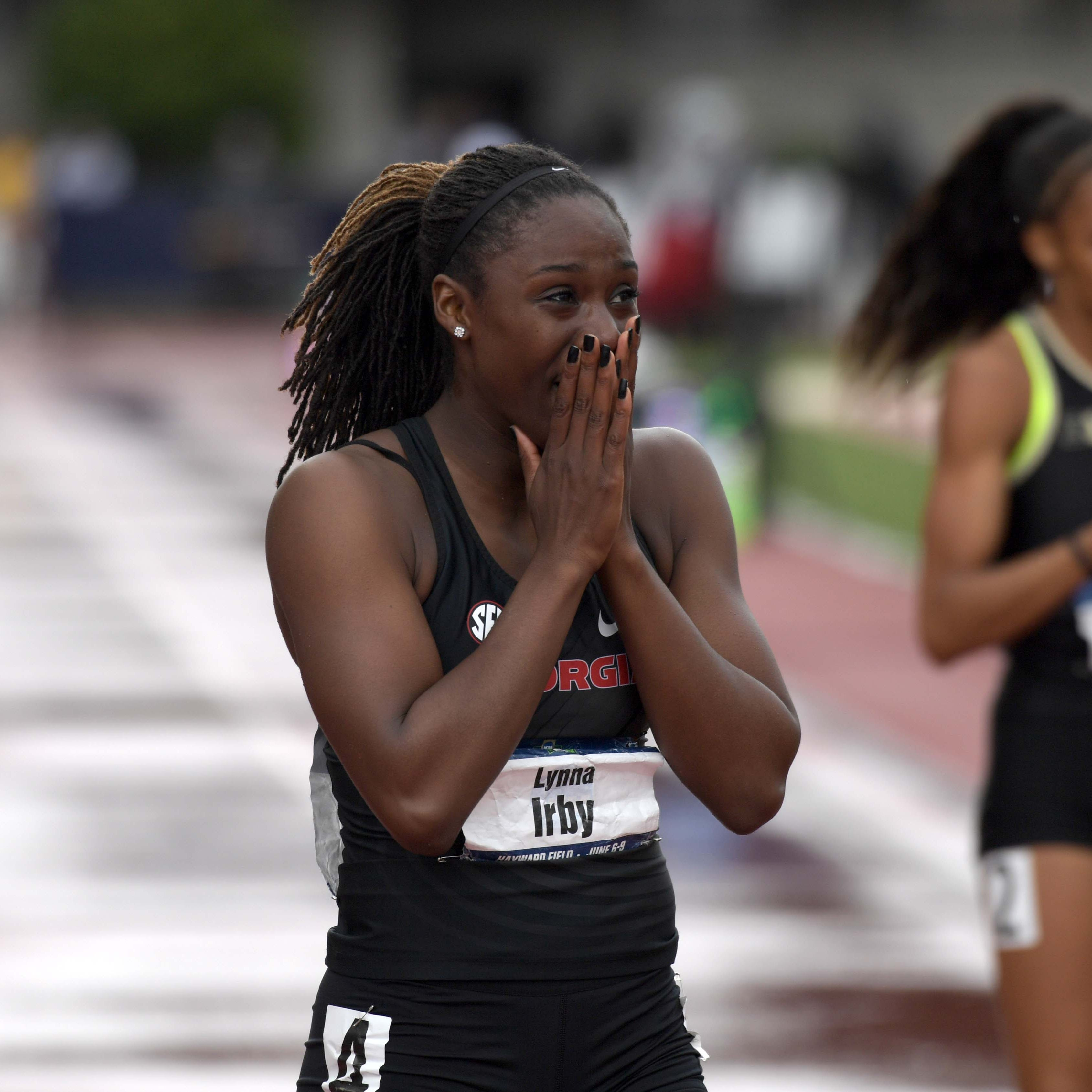 Lynna Irby of Georgia reacts after winning the women's 400m in a meet record 49.80 during the NCAA Track and Field championships at Hayward Field in 2018.