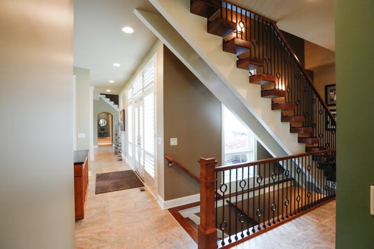 A back staircase is shown inside a 10,229 sq. foot home up for sale at 5347 N. 400, Bargersville, Ind., in the Mirada gated community, on Thursday, April 25, 2019. The single-family home, built in 2010, features five bedrooms, 2.49 acres on a stocked lake, six full baths, and two half baths.