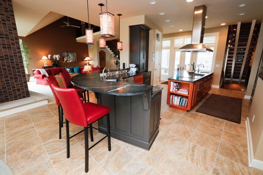 An open plan kitchen and living room, is shown inside a 10,229 sq. foot home up for sale at 5347 N. 400, Bargersville, Ind., in the Mirada gated community, on Thursday, April 25, 2019. The single-family home, built in 2010, features five bedrooms, 2.49 acres on a stocked lake, six full baths, and two half baths.