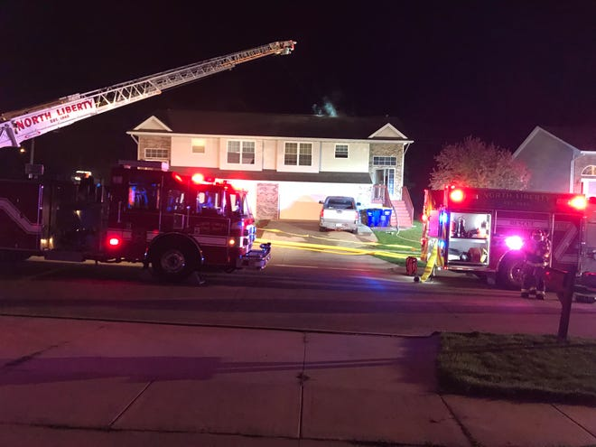 North Liberty firefighters contain a fire at a duplex after residents safely evacuated at around 1 a.m. Thursday, April 25, 2019.