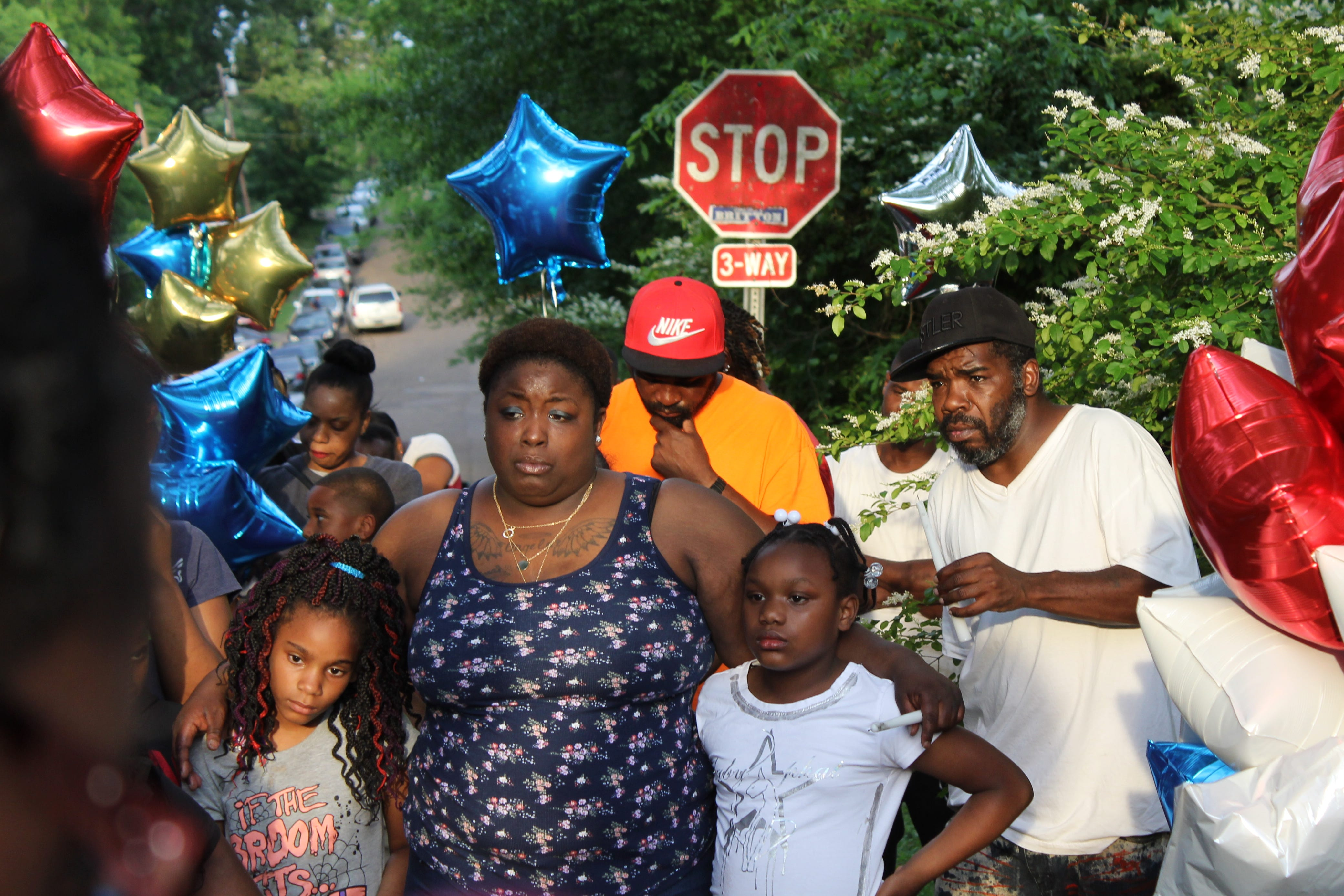 A woman holds two young girls close as people pray for Rodrick Johnson, a 14-year-old Jackson homicide victim. A vigil was held for Rodrick on Wednesday, April 24, 2019.