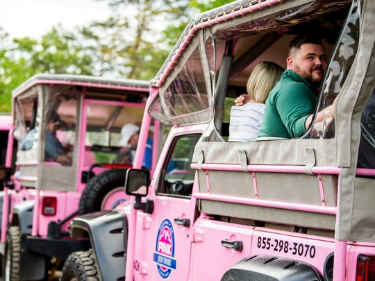 A guest waits for a ride to begin during a Pink Jeep Tours grand opening event held in Pigeon Forge on Thursday, April 25, 2019.