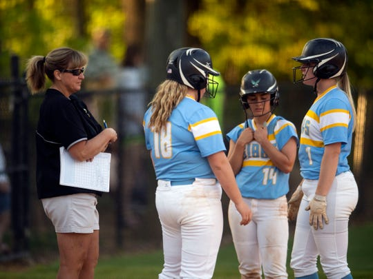 Gibbs softball coach Carol Mitchell talks with players during a game against Halls in late April.