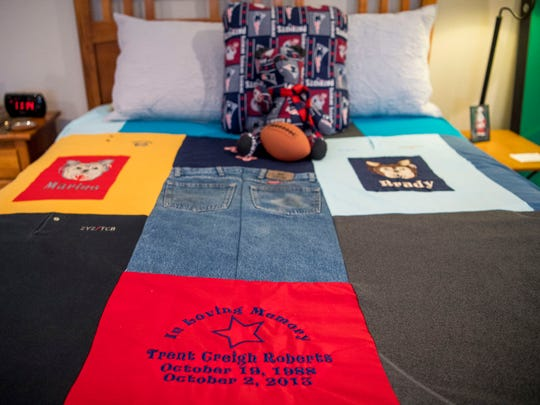 Clothing owned by Trent Roberts make up a quilt now on Roberts' bed on Monday, April 15, 2019. Roberts died in a car accident in 2013 when a tire blew on a church bus on Interstate 40, causing the bus to cross the median and crash into oncoming traffic.